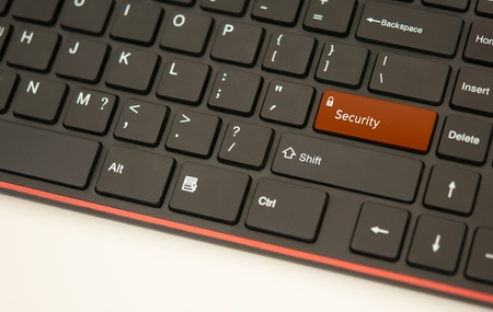 Security button on keyboard concept on white background photo