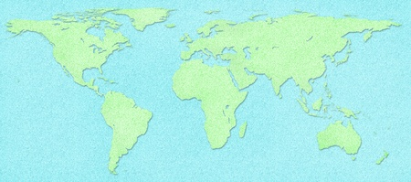 physical geography: Green world map on blue cork board background Stock Photo