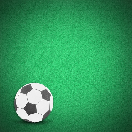 Football soccer ball by cork board on green grass Stock Photo - 13500822