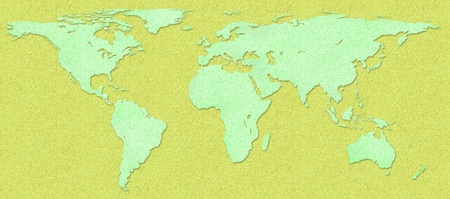 Green world map and earth globes on cork board background photo