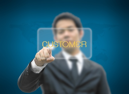 Business man concept hand pointing button customer word with world map background Stock Photo