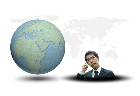 World map and earth globes by cork board with business man thinking on white background photo