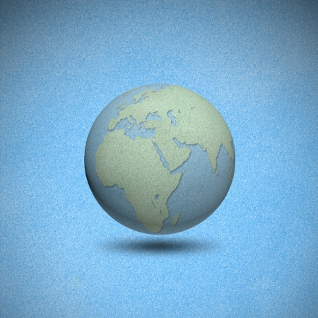 Earth globes by cork board with blue background photo