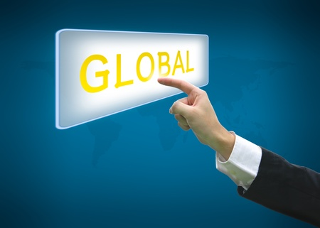 Business hand pointing global word on button with world map background Stock Photo - 13798465