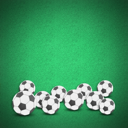 Football soccer ball craft on green grass background by cork board photo