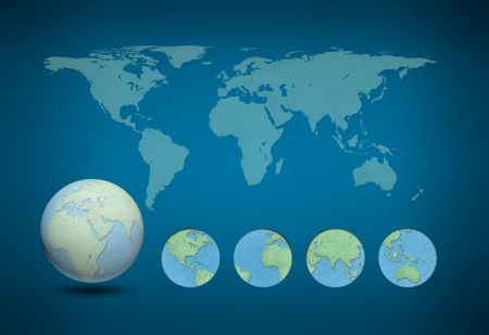 World map and earth globes by cork board on blue background photo