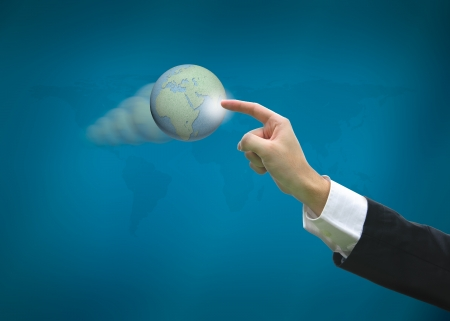 Business man pointing earth globes on world map background photo