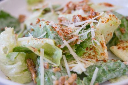 caesar salad: Caesar salad closeup on top of a table
