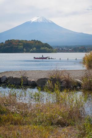 Mountain Fuji and lake kawaguchiko with fisherman on the boat Stock Photo