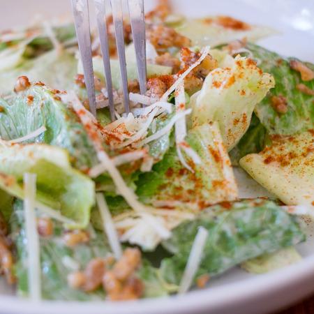 Caesar salad closeup on top of a table