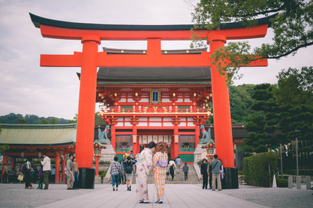 reachable: KYOTO, JAPAN - September 27, 2014: Fushimi Inari-taisha in Kyoto, Japan on November 19, 2013. The main shrine structure was built in 1499, reachable by a path lined with thousands of torii Editorial