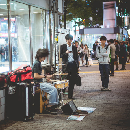 Japan, Japan - September 27, 2014: Drummer, drummer playing on the street at shibuya. Japan.