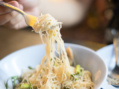 asian fried rice vermicelli with vegetables noodle on a bowl Stock Photo