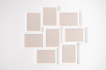 8 white wooden frame on white wall