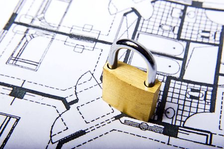padlock on plans document in white Stock Photo