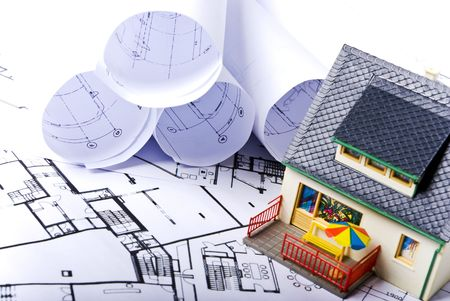 model house with some plans documents Stock Photo