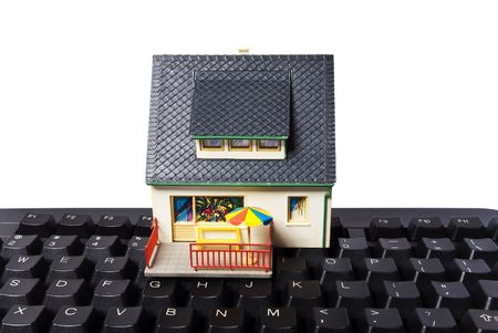model house with keyboard on white background photo