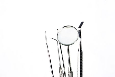 some dentall tools on white