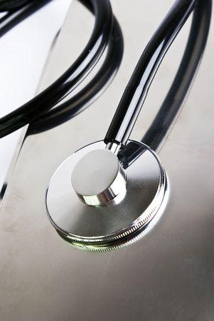 stetoscope: stetoscope in close range on  metal surfece
