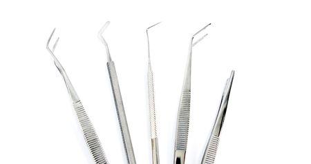 some dental tools on white photo