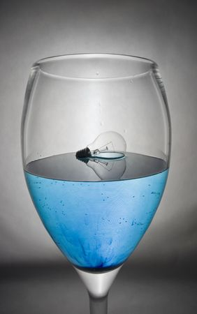 light in glass with blue liquid