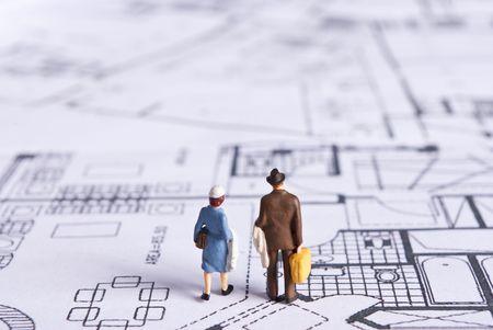 miniature people on plans photo