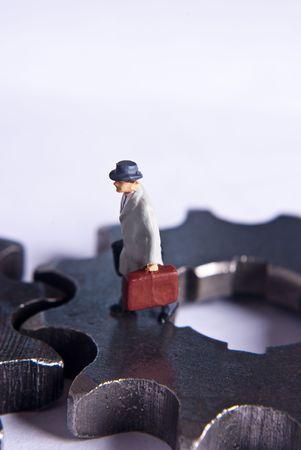 miniature man on gears Stock Photo - 7138003