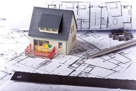 miniature house on plans document photo