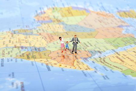 miniature family on travel photo