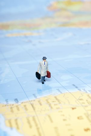 miniature man on world map Stock Photo - 7747520