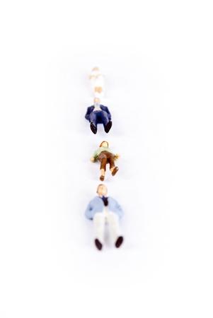 miniature people on white background Stock Photo - 8580065