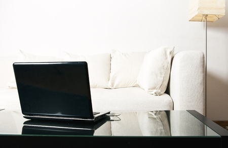 sofa with some pillow and computer