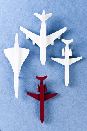 some airplanes in one roe on blue background Stock Photo - 9439754