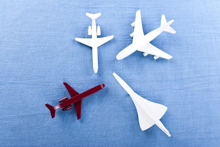 some airplanes in one roe on blue background Stock Photo - 9439756