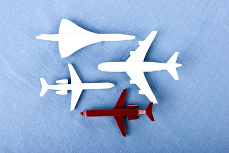 some airplanes in one roe on blue background Stock Photo - 9439755