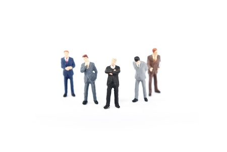 figurines: some busines people on stage