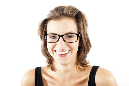 young woman smiling with glasses on her face photo