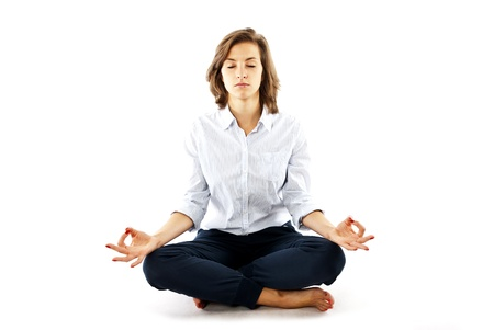 meditating: woman in yoga position