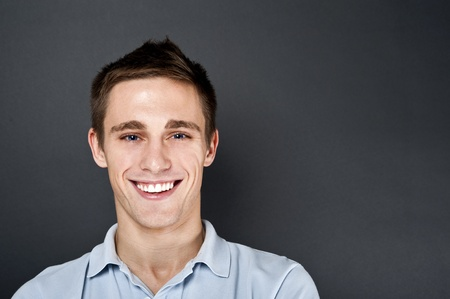 young man on black background Stock Photo