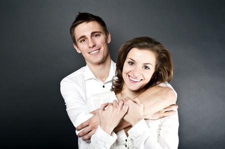 young woman and man together photo