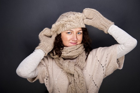 woman smiling with hat and gloves on her Stock Photo - 12206463