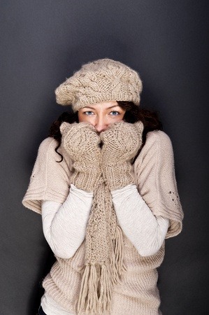 woman smiling with hat and gloves on her Stock Photo - 12206466