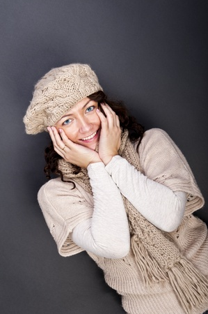 woman smiling with hat and gloves on her Stock Photo - 12206498