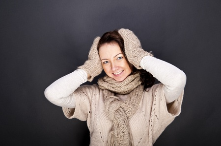 woman smiling with hat and gloves on her Stock Photo - 12206517