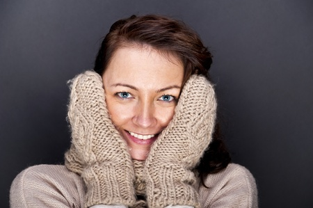 woman with winter glove's on her face photo