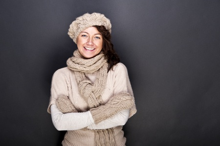 woman smiling with hat and gloves on her Stock Photo - 12206492