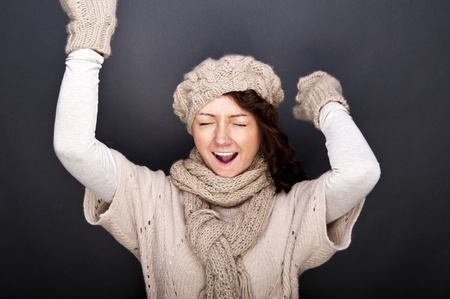 woman smiling with hat and gloves on her Stock Photo - 12206487