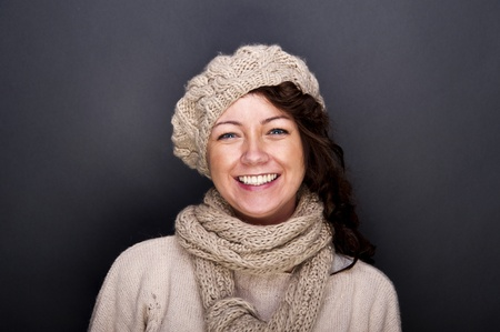 woman smiling with hat and gloves on her Stock Photo - 12206488