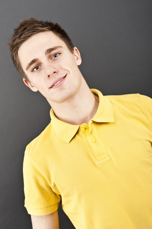 man on black background in polo shirt photo