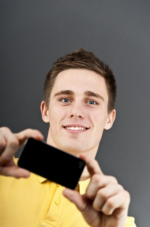 man holding mobile phone photo